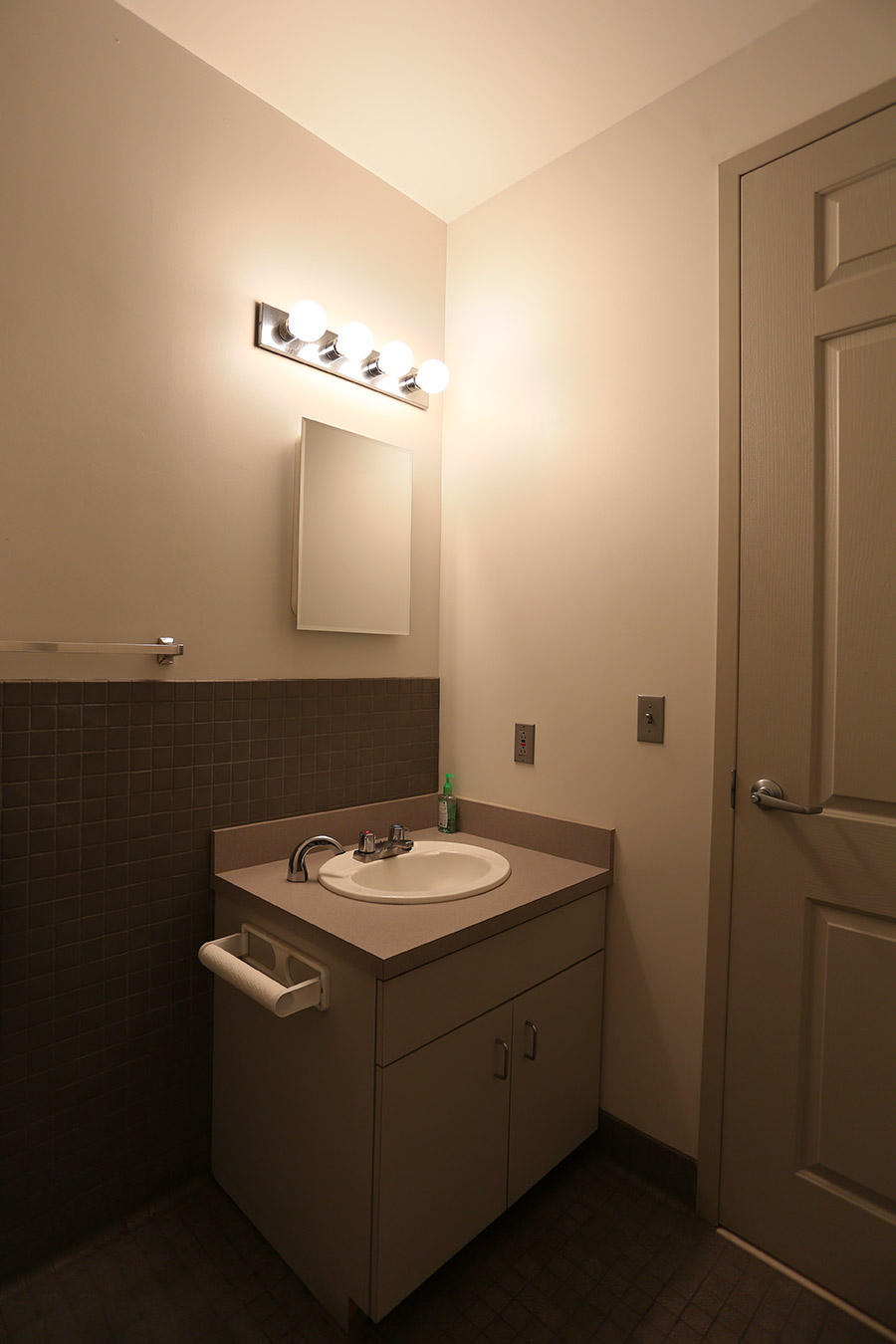 Bathroom fan with heater and light