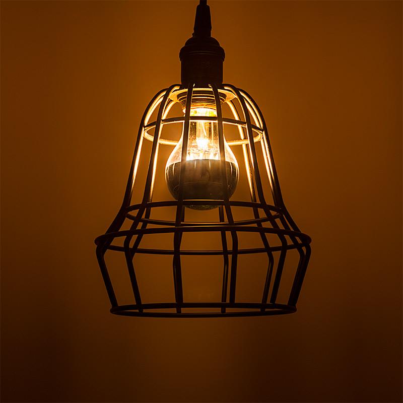 LED restaurant lighting - silver tip bulb above table