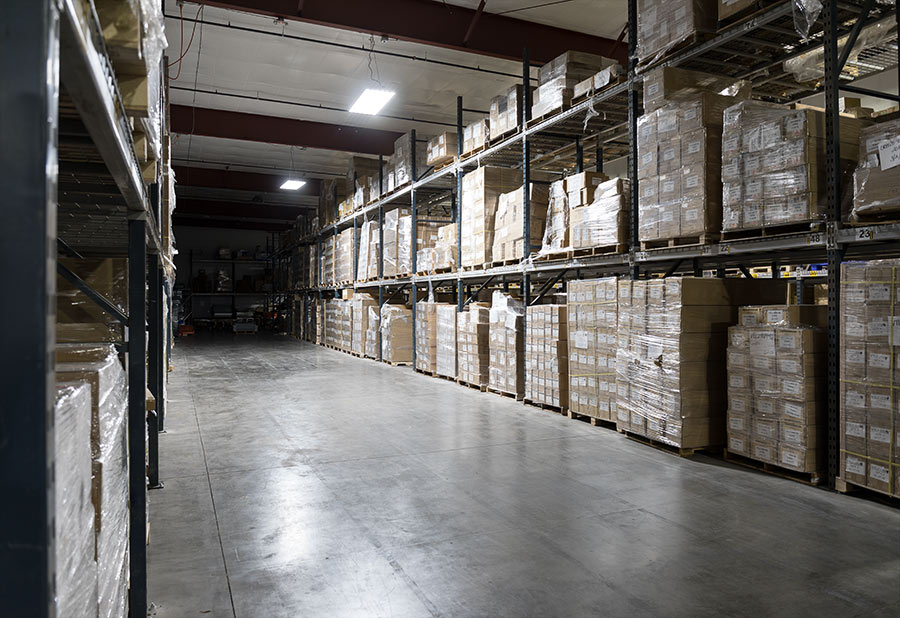 LED linear high bay lights in warehouse aisle