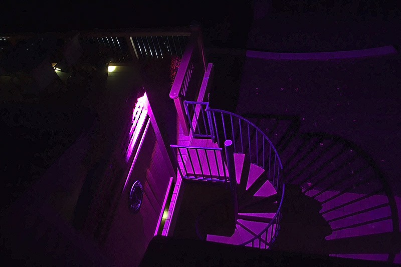 Landscape Lighting Design - flood light on deck stairs