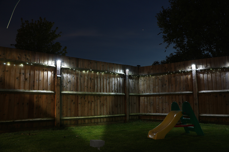 Landscape Lighting Design - flood light on fence