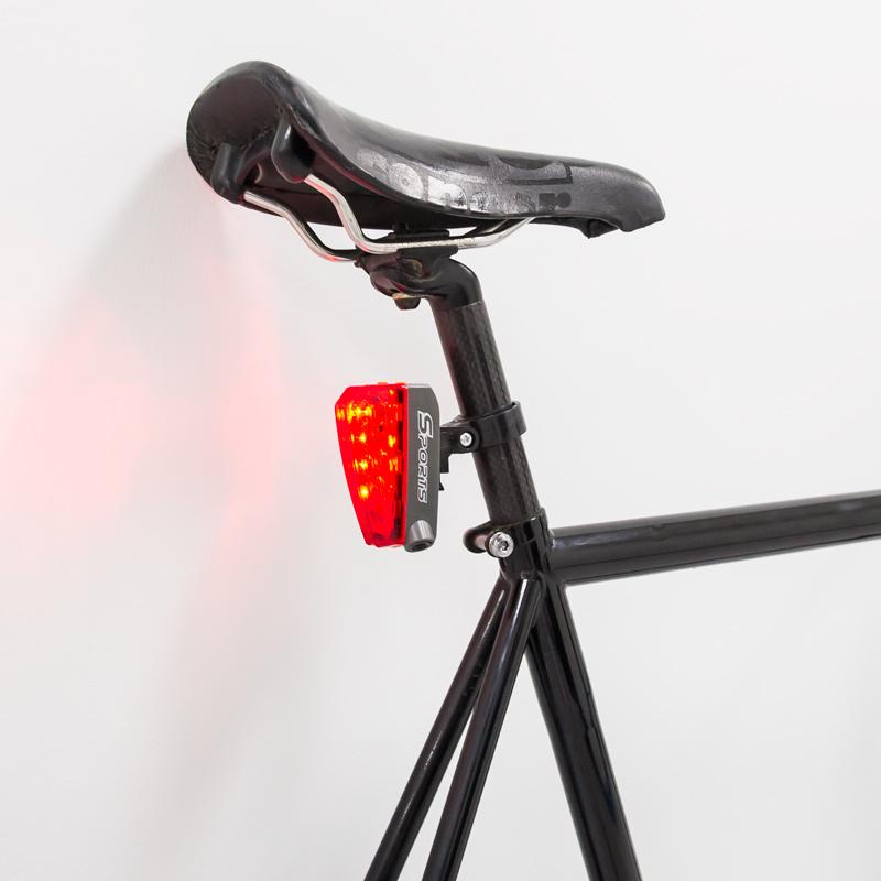 Led bicycle tail light with laser lane bike
