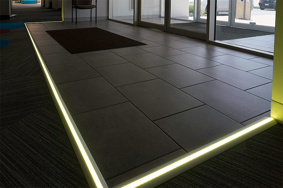 in floor lighting. angled surface mount aluminum profile housing for led strip lights - anodized channel: installed on ground in commercial building entrance floor lighting 1