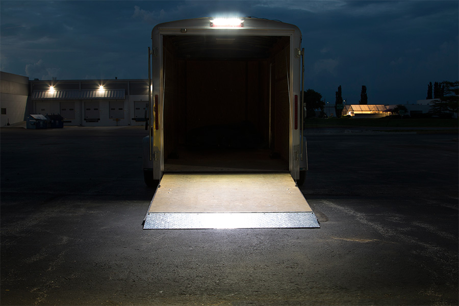 16 RV Awning Lights Shown Installed Over Trailer Gate In Natural White