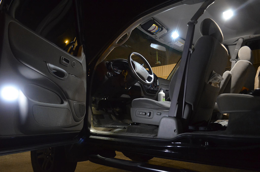 194 LED Bulb   3 SMD LED   Miniature Wedge Retrofit: Shown Installed In Car  Door In Cool White.