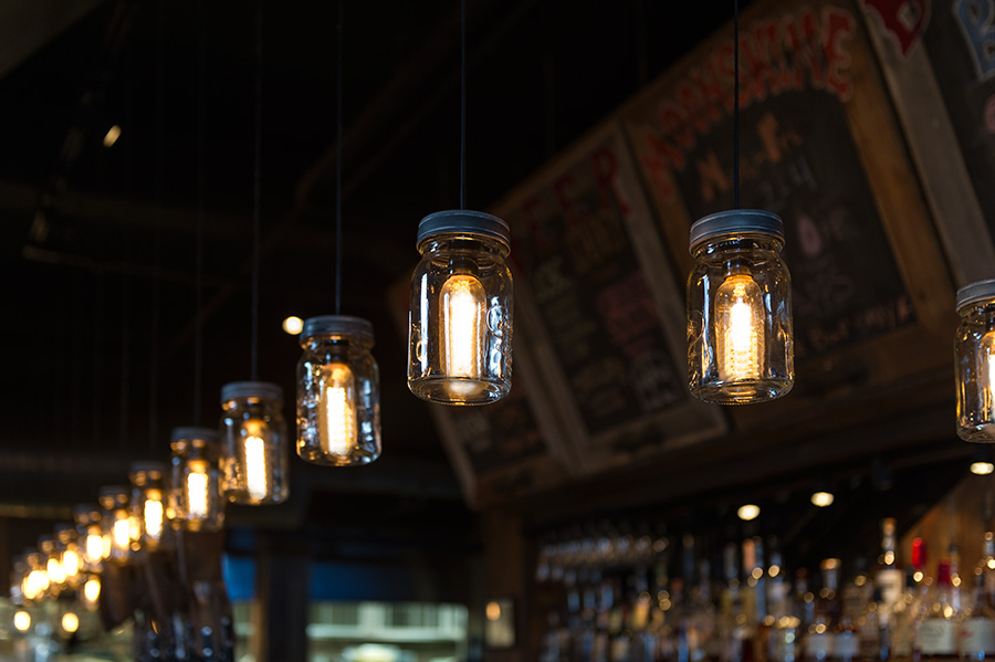 vintage style lighting fixtures. LED Vintage Light Bulb - Radio Style T10 W/ Filament Dimmable: Shown In Pendant Fixtures Over Bar Ultra Warm White. Lighting S