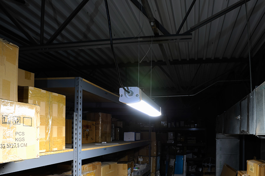 30w Linear Led Light Fixture Industrial 2 Long Shown Installed In Warehouse Aisle