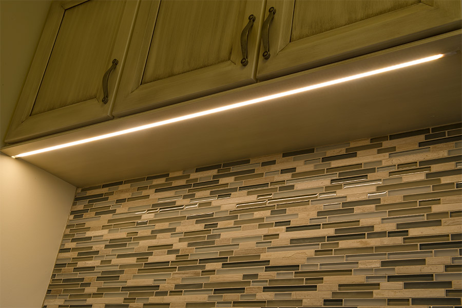 Surface Mount Anodized Aluminum LED Profile Housing   MICRO ALU: Channel  Shown Installed Under Custom Cabinets In Routed Groove.
