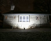 100 Watt High Power LED Flood Light Fixture: Shown Illuminating House From 5' And Approximately 45°Angle.