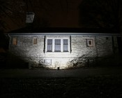 50 Watt High Power LED Flood Light Fixture: Shown Illuminating House From 5' And Approximately 45°Angle.