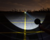 "6"" Round 10W Handheld Spot LED Work Light: Showing Beam Pattern Aimed At Treeline 500 Feet Away"
