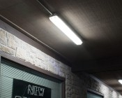 60W Vapor Tight Light Fixture - Industrial LED Light - 4' Long: Shown Installed In Front Of Stores.
