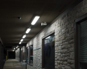 60W Vapor Tight Light Fixture - Industrial LED Light - 4' Long: Shown Installed Along Store Fronts.