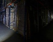 6189 REDLINE Select RC™ Rechargeable Tactical Flashlight with USB Powerbank: Shown Illuminating Warehouse Aisle In Maximum Width Beam (Left) And Narrowest Width Beam (Right).