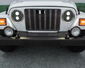 "7"" Round DOT Approved LED Headlights Conversion: Shown In Black Mounted On Jeep With DRL's On."