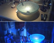 'Using one of the AE Series Angel Eyes in blue below our aqua green with glitter vessel bowl produced a surprisingly bright and amazing effect. The sink is normally lit by a 50 watt MR-16 spot (top picture) in a recessed fixture directly above it. Now, incredible!!' -John F.