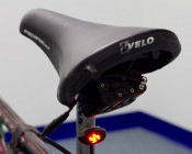 ALM series Small Oval Accent Light Module attached to bike frame. Powered by our Battery Power Supply