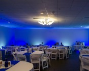 Alternating RGB and white LED flood lights were used to wash the walls of the reception hall in vibrant colors