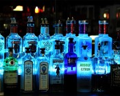 NFLS-RGB150-KIT Color Changing Flexible LED Light Strip Kit installed behind bottles cyan color