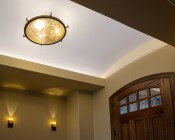 A19D Globe LED Bulb - 12 Watt: Show Installed In Overhead Fixture In Entryway In Warm White.