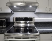 Angled Surface Mount Aluminum Profile Housing for LED Strip Lights: Shown As Kitchen Accent Lighting.