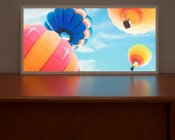 Even-Glow LED Panel Light - Balloon 1 LUXART Print - 2' x 4': Showing Panel On In Low Lit Room.