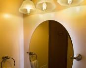 Universal Waterproof LED Light Strip Full Kits - LED Tape Light with 9 SMDs/ft., 3 Chip White SMD LED 5050: Shown Installed Behind Bathroom Mirror And On In Natural White.