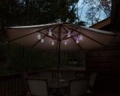 LED Bottle Light Bulbs w/ Integrated LED Fairy Lights - 50 Lumens - RGB Lights illuminating an  Table Unbrella