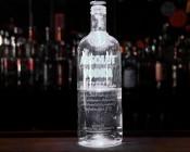Mini Recessed LED Accent Light - 1 Watt - Cool White: Shown Illuminating Bottle In Cool White.