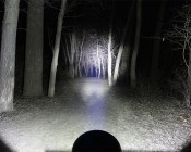 """7"""" Round 45W Heavy Duty High Powered LED Work Light On Trail In Woods"""