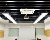 Dimmable 54W Up/Down LED Panel Light Fixture - 1ft x 4ft: Showing Multiple Panels Attached In Series And Hanging.