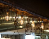 Flexible Filament LED Bulb - ST18 Carbon Filament Style Bulb - Dimmable 15 Watt Equivalent - Spiral Loop - 146 Lumens: Installed in Country Style BBQ Restaurant Bar