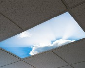 Even-Glow LED Panel Light - Sun Beams LUXART Print - Dimmable - 2' x 4': Shown Installed In Ceiling With Printed Overlay. Showing Similar Panel On.