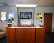 Flexible Surface Mount Aluminum Profile Housing for LED Strip Lights: Shown Installed On Curved Receptionist Desk.