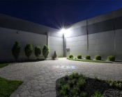 LED Area Light - 160W (500W HID Equivalent) - 5000K/3000K - 20,000 Lumens: Shown Illuminating Garden Area.
