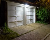 LED Motion Sensor Light - 2 Head Security Light - 24W: Shown Installed On Garage.