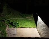LED Motion Sensor Light - 3 Head Security Light - 30W: Shown Illuminating Patio.