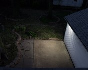 LED Motion Sensor Light - 2 Head Security Light - 20W: Showing Beam Pattern Off The Side Of Garage.