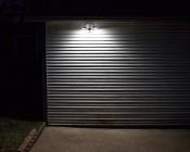 LED Motion Sensor Light - 2 Head Security Light - 24W: Showing Beam Pattern On Garage.