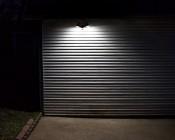 LED Motion Sensor Light - 2 Head Security Light - 20W: Shown Installed On Garage.