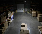100W LED Area Light - Natural White - 12,500 Lumens: Shown Illuminating Warehouse From Approximately 15'.