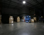 100W LED Area Light - Natural White - 12,500 Lumens: Shown Illuminating Warehouse Floor From Approximately 15'.