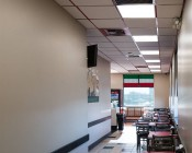 LED Panel Light - 2x2 - 6,500 Lumens - 50W Even-Glow® Light Fixture - Drop Ceiling Recessed Mount - Installed in Dining Room