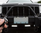 Wireless Remote Control Switch with Key Fob for Wire Harnesses: Shown Installed On Jeep And Controlling Daytime Running Lights.