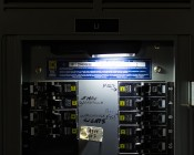 LarryC LED Work Light - NEBO Flashlight: Shown Attached To Breaker Box Via Magnetic Clasp And On.