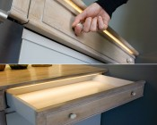 LED Strip used to illuminate a cabinet drawer housed in ECO series Surface Mount Anodized Aluminum Klus LED Profile Housing