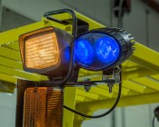 Blue LED Safety Light w/ Arrow Beam Pattern: Close Up of Light Installed on Forklift