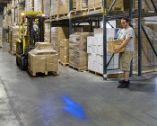Blue LED Safety Light w/ Arrow Beam Pattern: Installed on Forklift in Warehouse