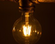 LED Filament Bulb - Gold Tint G30 LED Bulb with 6 Watt Filament LED - Dimmable: Shown Installed In Vintage Fixture.