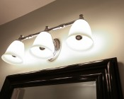 LED Filament Bulb - Silver Tipped A19 LED Bulb with 8 Watt Filament LED - Dimmable: Shown Installed In Bathroom Fixture.